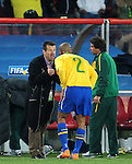 Dunga gives instructions to Maicon during the 2010 FIFA World Cup South Africa Round of Sixteen match between Brazil and Chile at Ellis Park Stadium on June 28, 2010 in Johannesburg, South Africa.