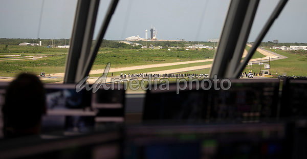 In this photo released by the National Aeronautics and Space Administration (NASA), Seen through the windows of firing room four of the Launch Control Center, a SpaceX Falcon 9 rocket carrying the company's Crew Dragon spacecraft is launched from Launch Complex 39A on NASA's SpaceX Demo-2 mission to the International Space Station with NASA astronauts Robert Behnken and Douglas Hurley onboard, Saturday, May 30, 2020, at NASA's Kennedy Space Center in Florida. The Demo-2 mission is the first launch with astronauts of the SpaceX Crew Dragon spacecraft and Falcon 9 rocket to the International Space Station as part of the agency's Commercial Crew Program. The test flight serves as an end-to-end demonstration of SpaceX's crew transportation system. Behnken and Hurley launched at 3:22 p.m. EDT on Saturday, May 30, from Launch Complex 39A at the Kennedy Space Center. A new era of human spaceflight is set to begin as American astronauts once again launch on an American rocket from American soil to low-Earth orbit for the first time since the conclusion of the Space Shuttle Program in 2011.<br /> Mandatory Credit: Joel Kowsky / NASA via CNP/AdMedia