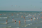 Bathers and wind surfers in the sea at Wissant, close to Cap Blanc Nez and the port of Calais.