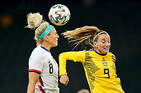 SOLNA, SWEDEN - APRIL 10: Julie Ertz #8 of the United States heads a ball during a game between Sweden and USWNT at Friends Arena on April 10, 2021 in Solna, Sweden.