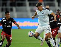 WASHINGTON, DC - MAY 13: Gaston Gimenez #30 of Chicago Fire FC battles for the ball with Andy Najar #14 of D.C. United during a game between Chicago Fire FC and D.C. United at Audi FIeld on May 13, 2021 in Washington, DC.