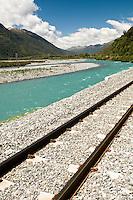 A railway next to the Taramakau River near Otira near Arthur's Pass.