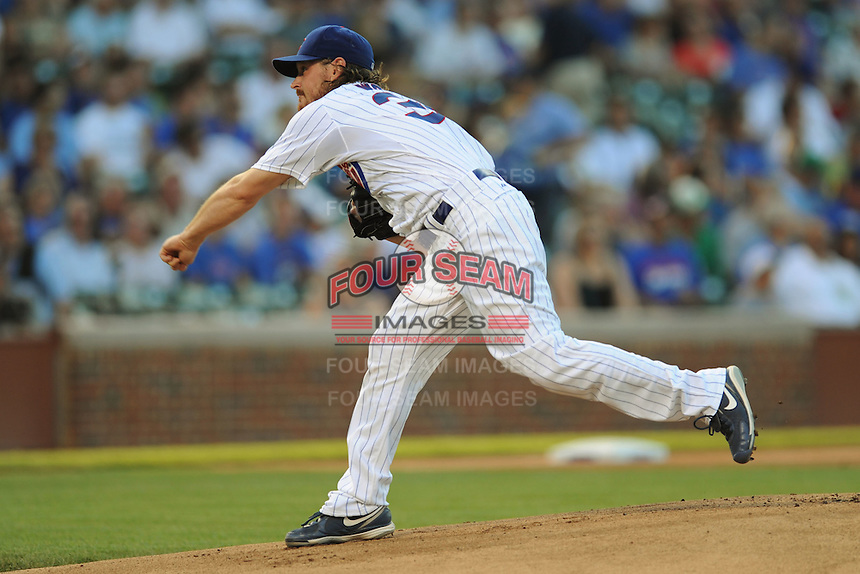 Chicago Cubs starting pitcher Travis Wood #30 delivers a pitch during a game against the Miami Marlins at Wrigley Field on July 17, 2012 in Chicago, Illinois. The Marlins defeated the Cubs 9-5. (Tony Farlow/Four Seam Images).