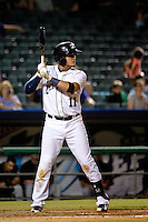 New Orleans Zephyrs shortstop Miguel Rojas (11) at bat against the Albuquerque Isotopes in a game at Zephyr Field on May 28, 2015 in Metairie, Louisiana. (Derick E. Hingle/Four Seam Images)