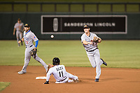 Mesa Solar Sox second baseman AJ Simcox (17), of the Detroit Tigers organization, makes a throw to first base on a double play attempt as Yonathan Daza (11) slides in with David Bote (15) backing up the play during a game against the Salt River Rafters on October 17, 2017 at Salt River Fields at Talking Stick in Scottsdale, Arizona. The Solar Sox defeated the Rafters 8-5.(Zachary Lucy/Four Seam Images)