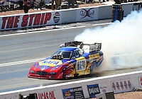 Apr. 5, 2009; Las Vegas, NV, USA: NHRA funny car driver Ron Capps does a burnout during eliminations of the Summitracing.com Nationals at The Strip in Las Vegas. Mandatory Credit: Mark J. Rebilas-