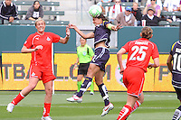 Shannon Boxx #7 of the Los Angeles Sol attempts a header against the Washington Freedom during their inaugural match at Home Depot Center on March 29, 2009 in Carson, California.