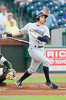 Jake Cave (6) of the Charleston RiverDogs follows through on his swing against the Greensboro Grasshoppers at NewBridge Bank Park on July 17, 2013 in Greensboro, North Carolina.  The Grasshoppers defeated the RiverDogs 4-3.  (Brian Westerholt/Four Seam Images)