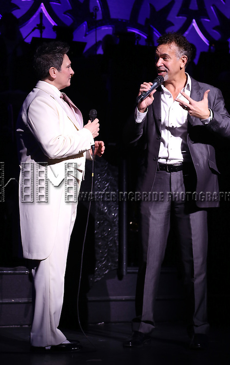 """Brian Stokes Mitchell introduces k.d. lang as she performs a special rare """"After Midnight"""" encore performance of her legendary rendition of the Leonard Cohen classic, """"Hallelujah"""" to raise money for the Actor's Fund at the Brooks Atkinson Theater on March 7, 2014 in New York City."""