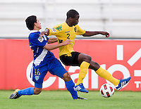 Oshane Jenkins (2) of Jamaica fights for the ball with Bryan Lemus (18) of Guatemala during the group stage of the CONCACAF Men's Under 17 Championship at Catherine Hall Stadium in Montego Bay, Jamaica. Jamaica defeated Guatemala, 1-0.