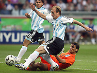 Argentina's Esteban Cambiasso (5) gets a shot off over Netherland's Khalid Boulahrouz (3).  Argentina and the Netherlands played to a 0-0 draw in their FIFA World Cup Group C match at FIFA World Cup Stadium, Frankfurt, Germany, June 21, 2006.