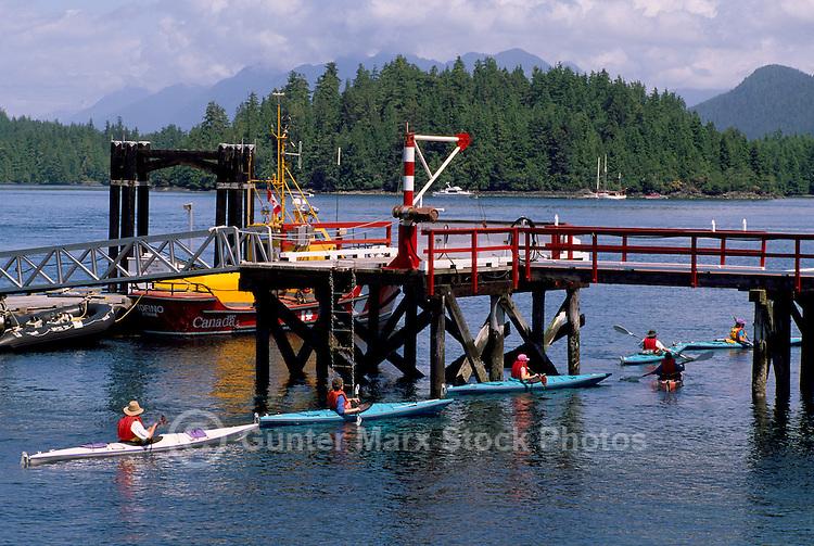 Tofino, Vancouver Island, BC, British Columbia, Canada - Kayakers touring on Ocean Kayak Trip, Summer