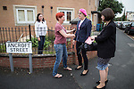 © Joel Goodman - 07973 332324 . 10/06/2016 . Manchester , UK . Comedian EDDIE IZZARD (2nd right) meets resident (and fan) RACHEL MORRIS (2nd left) when door knocking in Hulme , Manchester , in support of the Remain campaign , ahead of the UK's EU Referendum . Photo credit : Joel Goodman