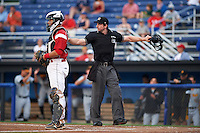 Umpire Matt Scott signals safe behind catcher Roy Morales during a game between the West Virginia Black Bears and Batavia Muckdogs on August 31, 2015 at Dwyer Stadium in Batavia, New York.  Batavia defeated West Virginia 5-4.  (Mike Janes/Four Seam Images)