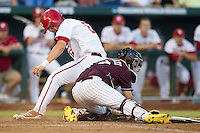 Mississippi State catcher Nick Ammirati (17) blocks home plate against Indiana Hoosiers baserunner Sam Travis (6) during Game 6 of the 2013 Men's College World Series on June 17, 2013 at TD Ameritrade Park in Omaha, Nebraska. Travis was called out and the Bulldogs defeated Hoosiers 5-4. (Andrew Woolley/Four Seam Images)