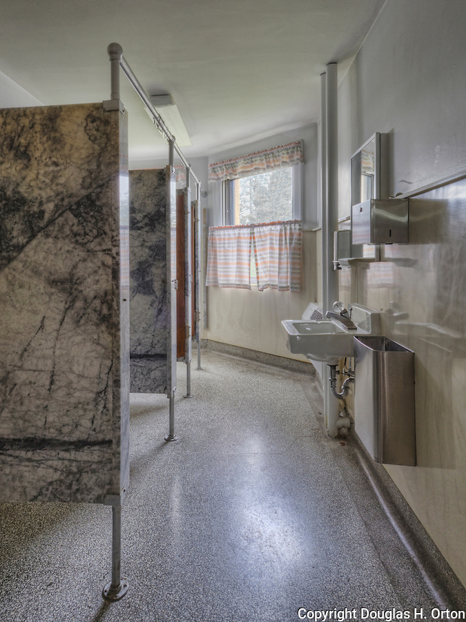Restroom Stalls, circa 1927, upscale, marble. Pink curtains.  Sink, marble dividers and floor. Please conact douglasorton@comcast.net regarding licensing of this image.