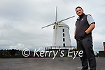 Donal Coppinger standing by the Blennerville Windmill where the sails have been taken down and are being replaced