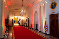 The Cross Hall of the White House is seen lit up for Pride month, Friday, June 25, 2021, as President Joe Biden participates in a Pride event in the Blue Room. (Official White House Photo by Adam Schultz)
