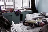 Kabul, Afghanistan<br /> November, 2001<br /> <br /> Indira Ghandi children's hospital - Malnutition Ward funded by Action Contra la Faim.<br /> <br /> Storai suffering from malnutrition comes from DaAfghanan Kabul, centeral Kabul, sleeps on a window ledge in the hospital.