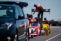 Aug 8, 2020; Clermont, Indiana, USA; Crew members make a rear wing adjustment to the dragster of NHRA top fuel driver Doug Kalitta during qualifying for the Indy Nationals at Lucas Oil Raceway. Mandatory Credit: Mark J. Rebilas-USA TODAY Sports