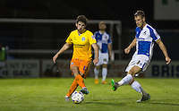 Max Kretzschmar of Wycombe Wanderers plays a pass under pressure from Lee Brown of Bristol Rovers during the Johnstone's Paint Trophy match between Bristol Rovers and Wycombe Wanderers at the Memorial Stadium, Bristol, England on 6 October 2015. Photo by Andy Rowland.