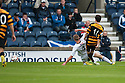 Alloa's Kevin Cawley scores their first goal.