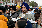 Free food is handed out to thousands of local residents on a procession through Southall, West London, to celebrate the Sikh festival of Vaisakhi.