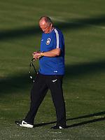 Brazil head coach Luiz Felipe Scolari checks his watch during training ahead of tomorrow's World Cup quarter final vs Colombia tomorrow
