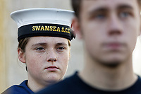 Pictured: A young female cadet during the service. Sunday 11 November 2018<br /> Re: Commemoration for the 100 years since the end of the First World War on Remembrance Day at the Swansea Cenotaph in south Wales, UK.