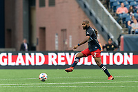 FOXBOROUGH, MA - JULY 25: Andrew Farrell #2 of New England Revolution passes the ball during a game between CF Montreal and New England Revolution at Gillette Stadium on July 25, 2021 in Foxborough, Massachusetts.