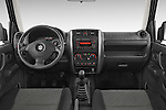 Stock photo of straight dashboard view of a 2014 Suzuki JIMNY JLX X-Citement 3 Door SUV 4WD Dashboard
