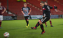Pars' Ryan Wallace scores their second goal from the penalty spot.