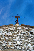 Ancient cross atop St Pauls church, Saint Paul de Vence, Provence, France