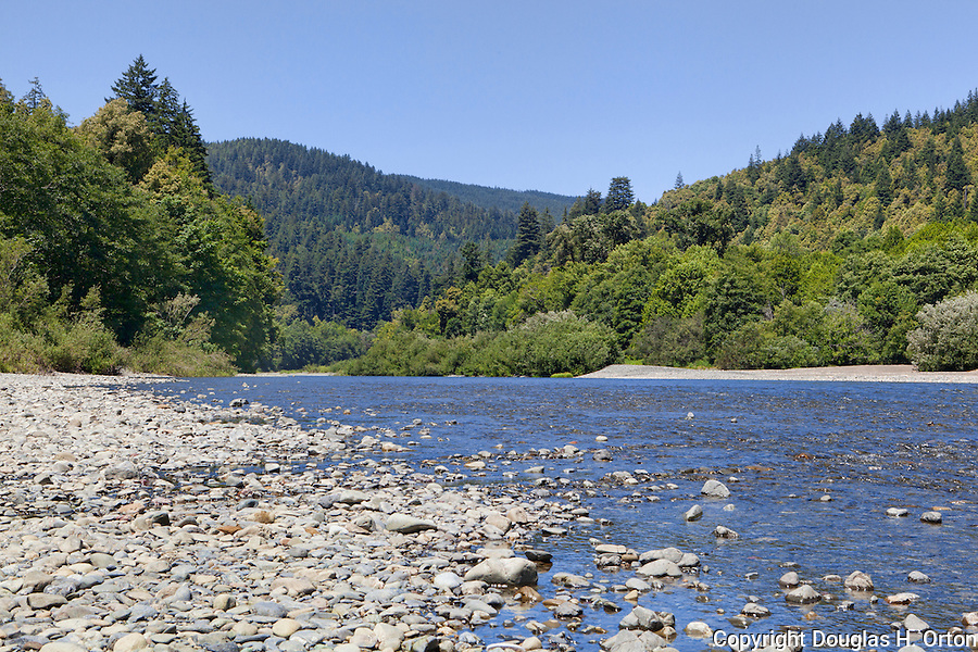 The Chetco River, designated a national Wild and Scenic River, runs wide and shallow as it approaches the Pacific Ocean at Alfred A. Loeb State Park near the town of Brookings, Oregon on the southern Oregon Coast.  The short Chetco river, only 56 miles long drops rapidly from coastal mountains to the Pacific Ocean.