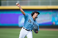 Durham Bulls starting pitcher Brent Honeywell (21) warms up in the outfield prior to the game against the Buffalo Bisons at Durham Bulls Athletic Park on April 30, 2017 in Durham, North Carolina.  The Bisons defeated the Bulls 6-1.  (Brian Westerholt/Four Seam Images)