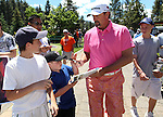 Former pro baseball player Bret Saberhagen signs autographs for fans before starting his parctice round at the 22nd American Century Celebrity Golf Championship at Edgewood Tahoe Golf Course in Stateline, Nev., on Wednesday, July 13, 2011. .Photo by Cathleen Allison