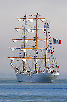 """The Mexican Navy's tall ship Cuauhtémoc sails into the fog on San Francisco Bay during a visit in 2005. Cuauhtémoc, whose name means """"eagle that swoops down over its prey"""" was the last emperor of the Aztecs. Built in 1982 at the Celaya Shipyards in Bilboa, Spain, the Cuauhtémoc has a spar length of 270 feet, draft of 17 feet 1 inch, beam of 39 feet 4 inches, and a weight of 1800 tons. Since her first transatlantic journey in 1982 she has sailed over 400,000 miles and in 1990 the vessel made a circumnavigation. Photographed 8/05"""