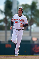 Baltimore Orioles designated hitter Mark Trumbo (45) running the bases during a Spring Training exhibition game against the Dominican Republic on March 7, 2017 at Ed Smith Stadium in Sarasota, Florida.  Baltimore defeated the Dominican Republic 5-4.  (Mike Janes/Four Seam Images)