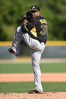 Pitcher Edinson Volquez (36) of the Pittsburgh Pirates during a minor league spring training camp day game on March 30, 2014 at Pirate City in Bradenton, Florida.  (Mike Janes/Four Seam Images)