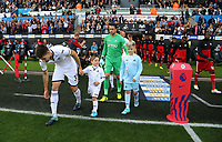 (L-R) Federico Fernandez and Lukasz Fabianski of Swansea City take to the pitch during the Premier League match between Swansea City and Watford at The Liberty Stadium, Swansea, Wales, UK. Saturday 23 September 2017
