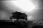 A lightning storm moves along the Forgotten Coast during a full moon at Shell Point Beach in Waklulla County, Florida in the Florida panhandle.<br /> ©2013 Mark Wallheiser