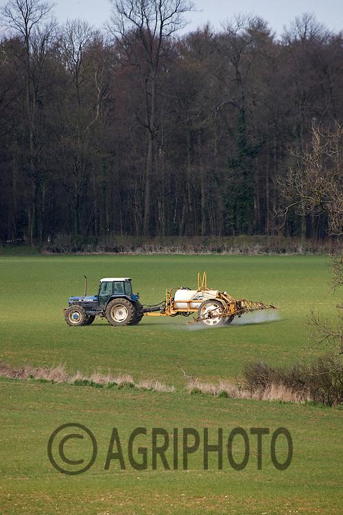 Tractor And Crop Sprayer Spraying Crops