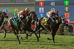 DEL MAR, CA  AUGUST 18:#5 Fatale Bere, ridden by Kent Desormeaux, and #4 Ollie's Candy, ridden by Tyler Baze, battle in the stretch of the Del Mar Oaks Presented by The Jockey Club (Grade 1) on August 18, 2018 at Del Mar Thoroughbred Club in Del Mar, CA.(Photo by Casey Phillips/Eclipse Sportswire/Getty ImagesGetty Images