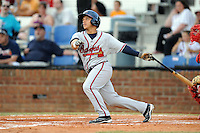 Danville Braves designated hitter Bryan De La Rosa #26 swings at a pitch during a game against the Johnson City Cardinals at Howard Johnson Field on June 23, 2013 in Johnson City, Tennessee. The Cardinals won the game 5-4. (Tony Farlow/Four Seam Images)