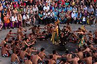Bali, Indonesia.  Spectators watch the Kecak Dance, in an Arena adjacent to Uluwatu Temple.