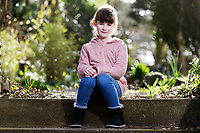 Pictured: Elly Neville at her home in Pembroke, west Wales, UK. Tuesday 20 February 2018<br /> Re: Seven-year-old Elly Neville who was born despite doctors saying her parents would not be able to have any more children, has raised over £150,000 for the cancer ward that treated her father.<br /> Her parents Lyn and Ann had been told they were unlikely to have more children after he underwent a bone marrow transplant in 2005. <br /> Mr Neville subsequently spent a lot of time on the Ward 10 cancer facility at Withybush Hospital in Haverfordwest, Pembrokeshire.<br /> But four years later they were stunned when his painter and decorator wife Ann fell pregnant again.