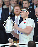 Prince Harry looks on as England captain Dylan Hartley lifts the Calcutta Cup during the RBS 6 Nations match between England and Scotland at Twickenham Stadium on Saturday 11th March 2017 (Photo by Rob Munro/Stewart Communications)