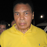 MIAMI BEACH, FL - JANUARY 02, 2007: (EXCLUSIVE COVERAGE) Aging Boxing legend Muhammad Ali getting help leaving Joe's Stone Crab Restaurant in Miami Beach.  Ali  is so fragile he needed to literally be propped up to pose with a fan for a picture<br /> <br /> People:  Muhammad Ali