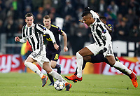 Football Soccer: UEFA Champions League Juventus vs Tottenahm Hotspurs FC Round of 16 1st leg, Allianz Stadium. Turin, Italy, February 13, 2018. <br /> Juventus' Alex Sandro (r) in action with his teammate Federico Bernardeschi (l) during the Uefa Champions League football soccer match between Juventus and Tottenahm Hotspurs FC at Allianz Stadium in Turin, February 13, 2018.<br /> UPDATE IMAGES PRESS/Isabella Bonotto