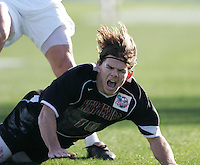 New Mexico's Lance Watson grimaces as he is knocked to the ground. The University of Maryland Terrapins defeated the University of New Mexico Lobos 1-0 in the Men's College Cup Championship game at SAS Stadium in Cary, NC, Friday, December 11, 2005.